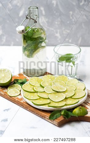 Bottle of cold fresh lemonade drink with mint and green lime