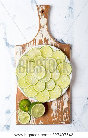 Citrus fruits. Fresh sliced limes on the ceramic plate