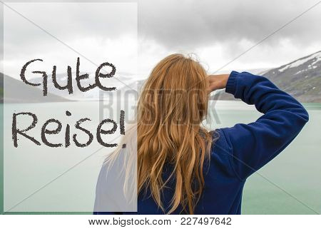 German Text Gute Reise Means Good Trip. Caucasian Woman Enjoys The View To A Glacier In Norway. Lake