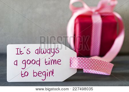 Label With English Quote It Is Always A Good Time To Begin. Pink Gift Or Present With Gray Cement Ba