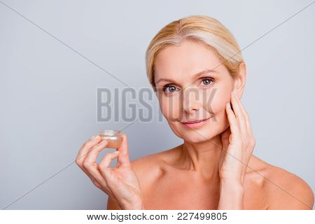 Portrait Of Pretty, Charming, Attractive, Pure, Nude Woman Having Jar With Face Cream In Hand, Using