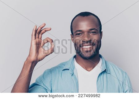 Portrait Of Virile, Harsh, Trendy, Cheerful, Glad Man With Beaming Smile Showing Ok Sign With Finger