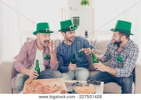 Happy St Patrick's Day! Portrait Of Stylish, Handsome, Attractive Guys Holding Pieces Of Pizza In Ha