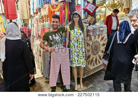 Tehran, Iran - April 29, 2017: A Smiling Iranian Man Embraces With A Female Mannequin Dressed In A S