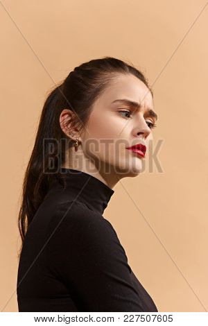 Serious, Sad Business Woman Standing, Looking Down Isolated On Trendy Pastel Studio Background. Beau