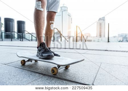 Close Up Male Legs Riding On Skate At Street. Copy Space