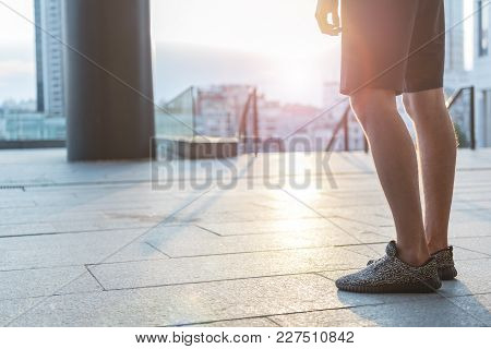 Close Up Athlete Legs Having Break After Training Outdoor. Sport Concept. Copy Space