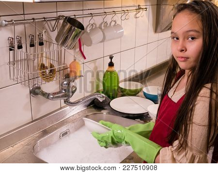 Asian  American Girl Washing Dishes