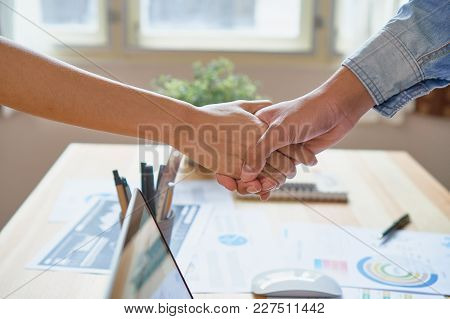 Joint Hands Of Two Businessmen After Negotiating A Successful Business Agreement, And The Handshake