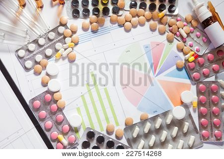 Medical Marketing And Health Care Business Analysis Report. Pile Of Pills In Blister Packs Backgroun