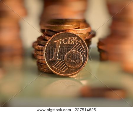 Coin One Euro Cent. Coin On A Blurry Background Of Coins. Currency Of The European Union.