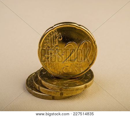 Twenty Euro Cent Coins Lie On A Pile Of Coins. Coins On The Blurred Background. Currency Of The Euro