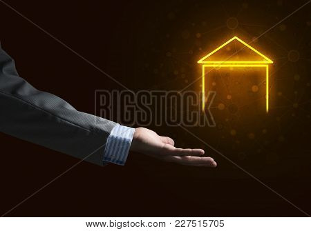 Businessman Hand Presenting Glowing Home Icon Or Symbol