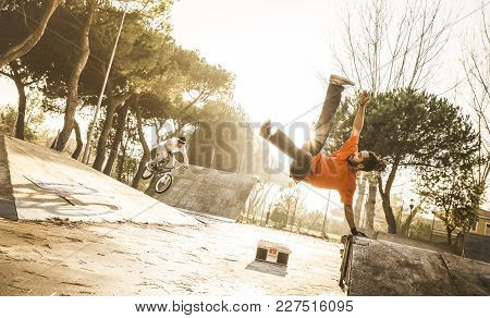 Urban Athlete Breakdancer Performing Acrobatic Jump Flip At Skate Park - Guy Riding Bmx Bicycle Behi