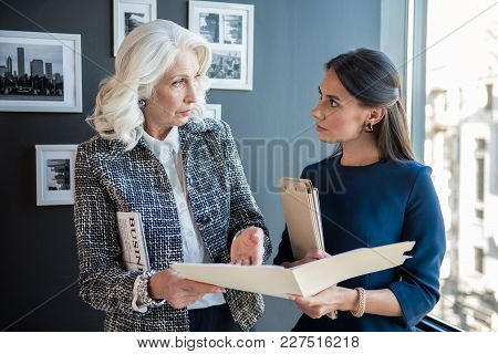 It Is Necessary To Alter. Senior Qualified Boss Female Is Pointing On Documents While Holding Folder
