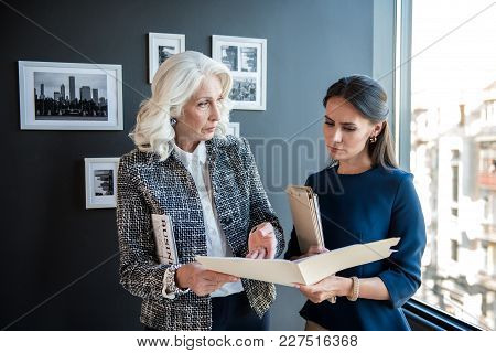 Here Is Mistake. Confident Old Gray-haired Lady Boss Is Pointing On Data In Documents And Reproachin