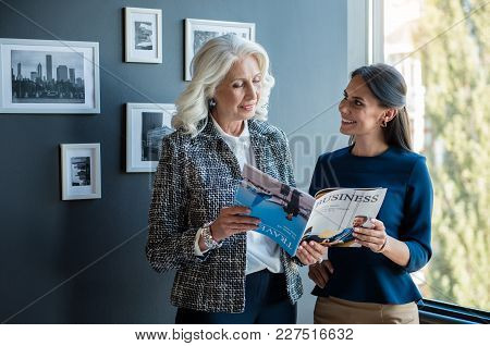Article About Our Company. Elegant Gorgeous Old Woman Is Standing With Her Young Attractive Female C