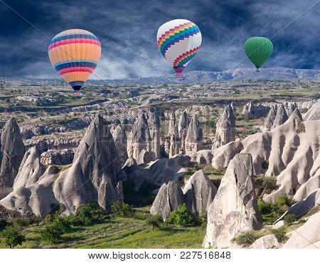 Colorful Hot Air Balloons Flying Over Valleys In Cappadocia, Anatolia, Turkey