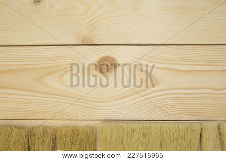 Repair, Redecorating Concept. Light Uncolored Wooden Background With New Paint Brushes, Close Up, To