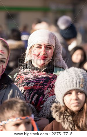 Pernik, Bulgaria - January 26, 2018: Teens With Fake Blood Make-up Smile And March To Banish Away Ev