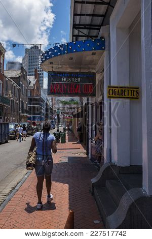 New Orleans, Louisiana - June 18, 2014: Street Scene At The Bourbon Street, In The French Quarter In