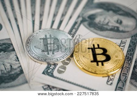 Shiny Golden And Silver Bitcoin On Top Of Dollar Banknote Background, Crypto Currency Concept, Futur