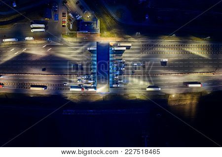 Aerial Drone View On Toll Collection Point On Motorway At Night.