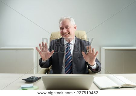 Smiling Aged Financial Adviser Asking You To Calm Down