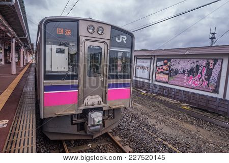 Akita, Japan - October 23,2017 : The Pink Strip Jr East 701 Series Commutor Local Train At Kakunodat