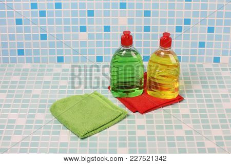 Accessory of hygiene and perfumery on the tile in the bathroom