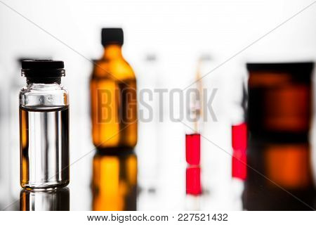 Group Object Of Liquid Medicinal Agent In Limpid Glassware In Medical Laboratory. Group Of Ampoules
