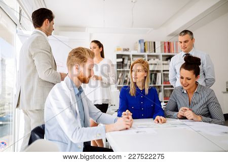 Succeful Business Partners Brainstorming In Modern Office