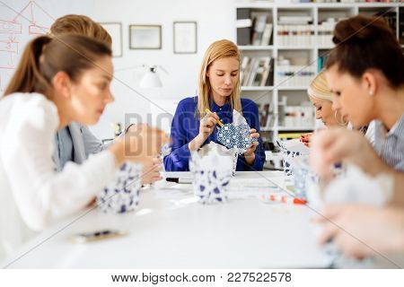 Colleagues Eating In Office During Lunch Break