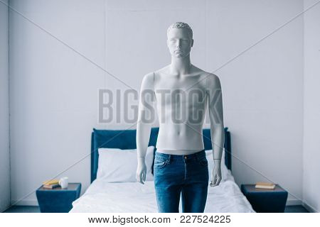 Close Up View Of Layman Doll In Jeans In Bedroom