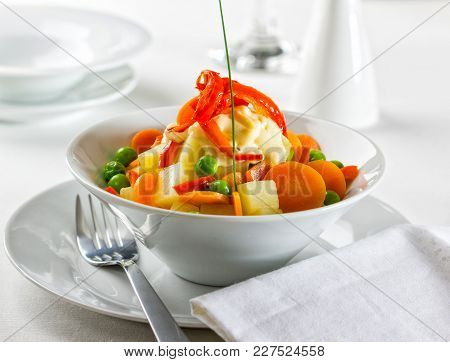 Fresh Vegetarian Spring Salad Topped With Mayonnaise And Fried Bell Pepper.