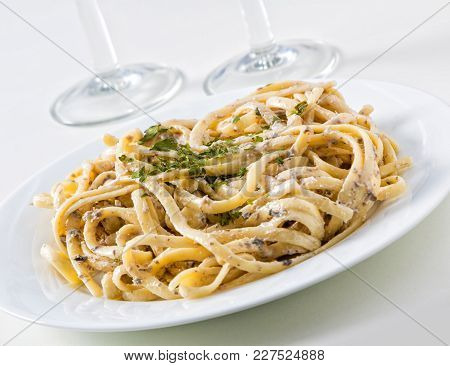 A Plate Of Tagliatelle With Mushroom Sauce.