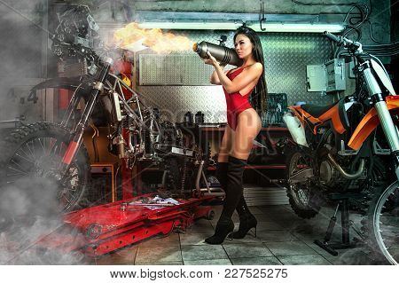 Sexy Girl In Garage With Motorcycles