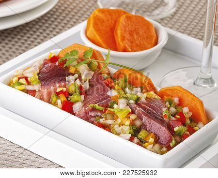 Seafood Ceviche Made With Tuna Fish And Served With Sweet Potato.