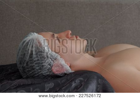 Man In The Spa On Facial Cleansing And Moisturizing Procedures