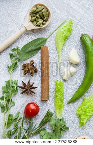 Set Of Spices And Herbs On Black Background