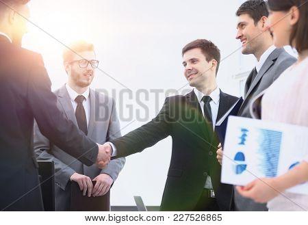 handshake business partners before business meeting