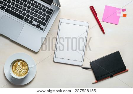 Blank Tablet Screen With Copy Space For Writing A Message Lying On Office Desk As Flat Lay From Abov