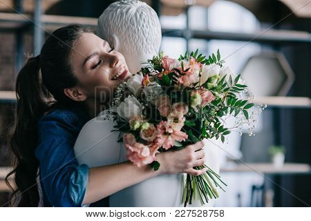 Smiling Woman With Bouquet Of Flowers Hugging Layman Doll, Perfect Relationship Dream Concept