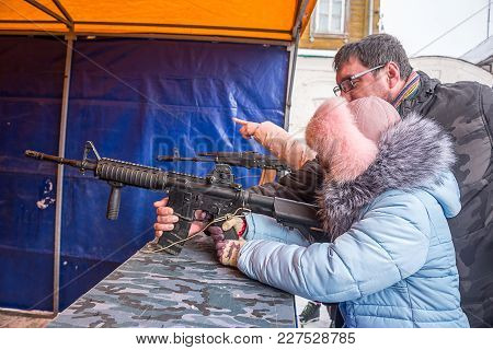 Child With Dad In The Dash, Shoot At Targets At The Festival