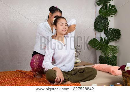 Beautiful Young Woman Getting Thai Masseuse Doing Massage By The Therapists On The Bed In Sap Salon,