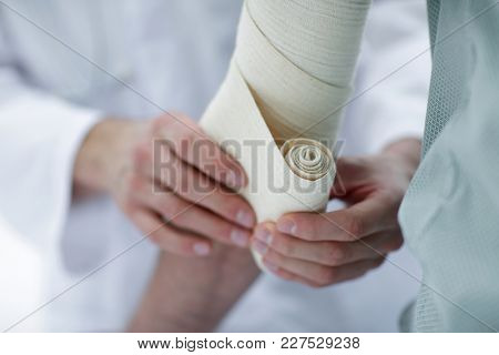 closeup.doctor applying elastic bandage