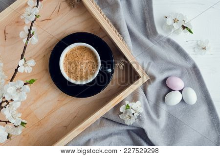 Cup Of Coffee Espresso, Colorful Chocolate Eggs And Cherry Blossom On Wooden Tray On White Shabby Ch
