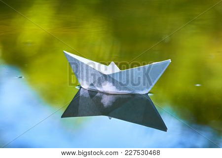 paper boat on the water