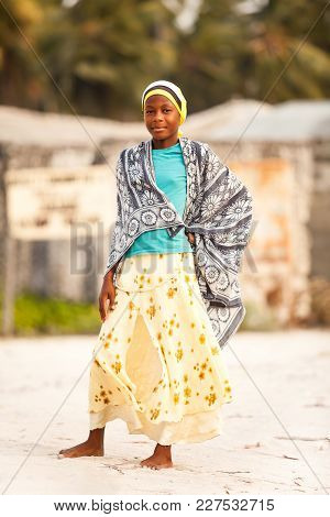 Muslim Girl Standing On Road Wrapped In A Cloth.