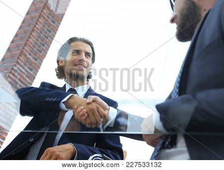 bottom view. confident handshake of business partners